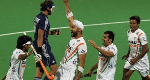 India's Sandeep Singh (C) celebrates with teammates after scoring a goal against France during their London 2012 Olympic Games men's field hockey final qualifying match in New Delhi February 26, 2012. REUTERS/B Mathur (INDIA - Tags: SPORT OLYMPICS FIELD HOCKEY) - RTR2YH2N