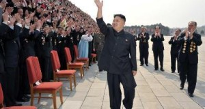 North Korean leader Kim Jong-Un (C) waves as he arrives to take pictures with officials, creators and employees of the Mansudae Art Studio in Pyongyang April 19, 2012 in this picture released by the North's KCNA on Thursday.  REUTERS/KCNA  (NORTH KOREA - Tags: POLITICS) QUALITY FROM SOURCE. THIS IMAGE HAS BEEN SUPPLIED BY A THIRD PARTY. IT IS DISTRIBUTED, EXACTLY AS RECEIVED BY REUTERS, AS A SERVICE TO CLIENTS. NO THIRD PARTY SALES. NOT FOR USE BY REUTERS THIRD PARTY DISTRIBUTORS