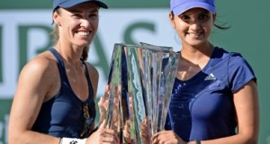 Mar 21, 2015; Indian Wells, CA, USA; Martina Hingis (SUI) and Sania Mirza (IND) with the championship trophy after winning their doubles final match against Ekaterina Makarova (RUS) and Elena Vesnina (RUS) in the BNP Paribas Open at the Indian Wells Tennis Garden. Hingis/Mirza won 6-3, 6-4. Mandatory Credit: Jayne Kamin-Oncea-USA TODAY Sports - RTR4UC1F