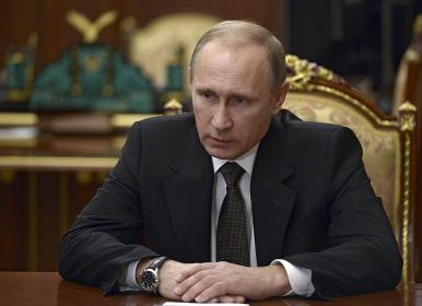 Russian President Vladimir Putin chairs a meeting on Russian plane crash in Egypt at the Kremlin in Moscow, Russia November 17, 2015. The Kremlin said for the first time on Tuesday that a bomb had ripped apart a Russian passenger jet over Egypt last month and promised to hunt down those responsible and intensify its air strikes on Islamist militants in Syria in response. REUTERS/Alexei Nikolskyi/SPUTNIK/Kremlin ATTENTION EDITORS - THIS IMAGE HAS BEEN SUPPLIED BY A THIRD PARTY. IT IS DISTRIBUTED, EXACTLY AS RECEIVED BY REUTERS, AS A SERVICE TO CLIENTS.