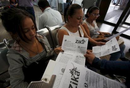Colombian women listen as a health worker distributes